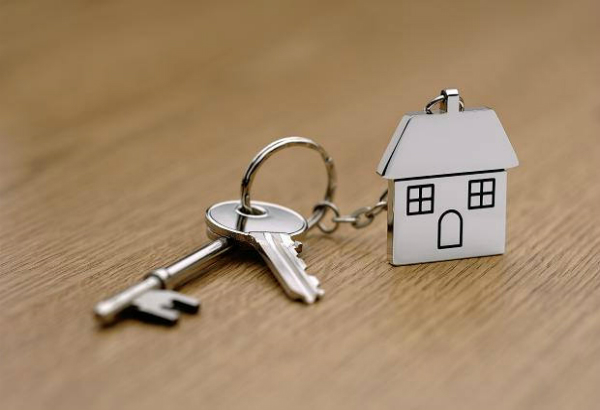 key chain with house key and metal house