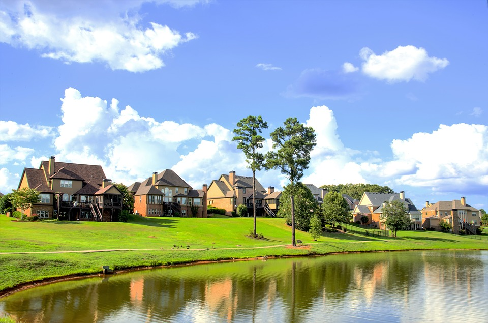 nice large homes on gold course in daylight