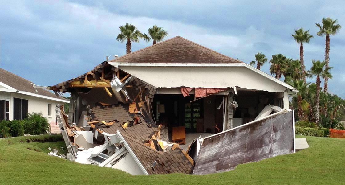 sinkhole collapses under house