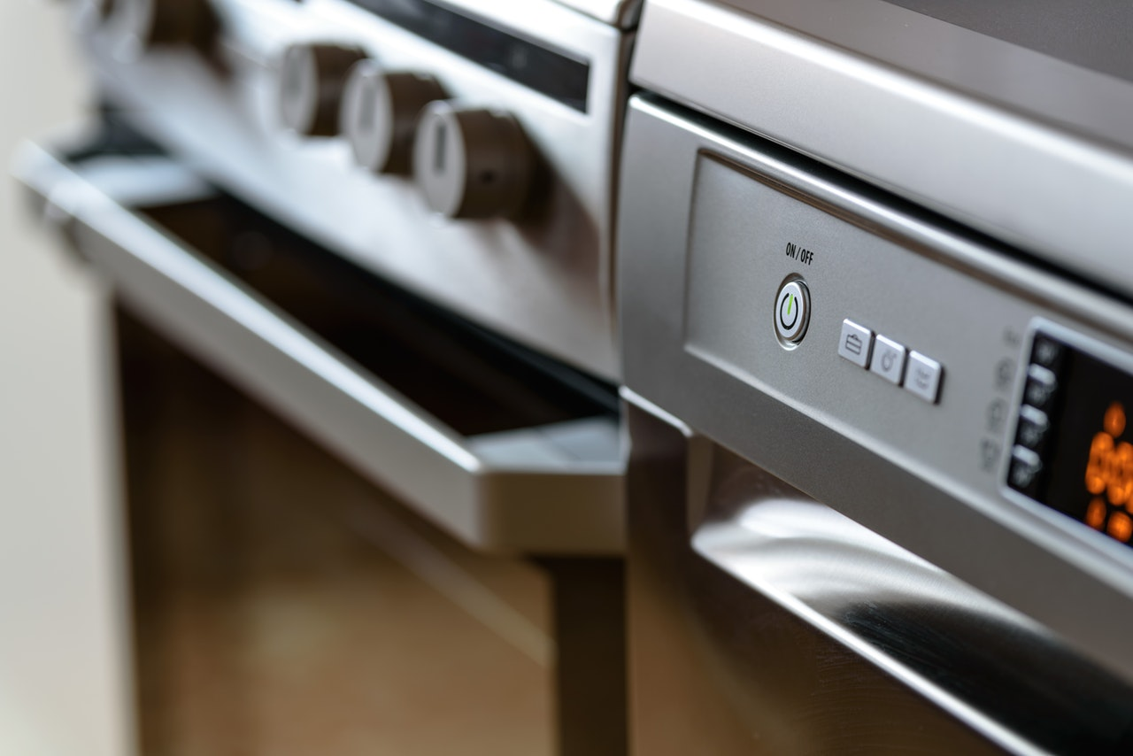 close up of stainless steel oven and appliances