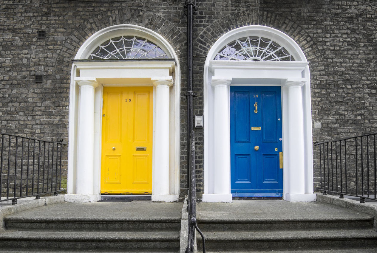 duplex home with two doors in yellow and blue