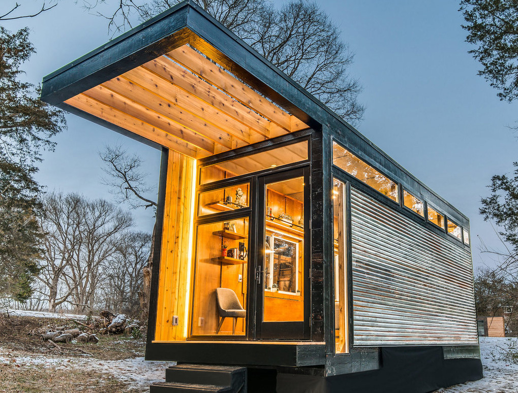 fancy tiny home lit up with wooden rafters