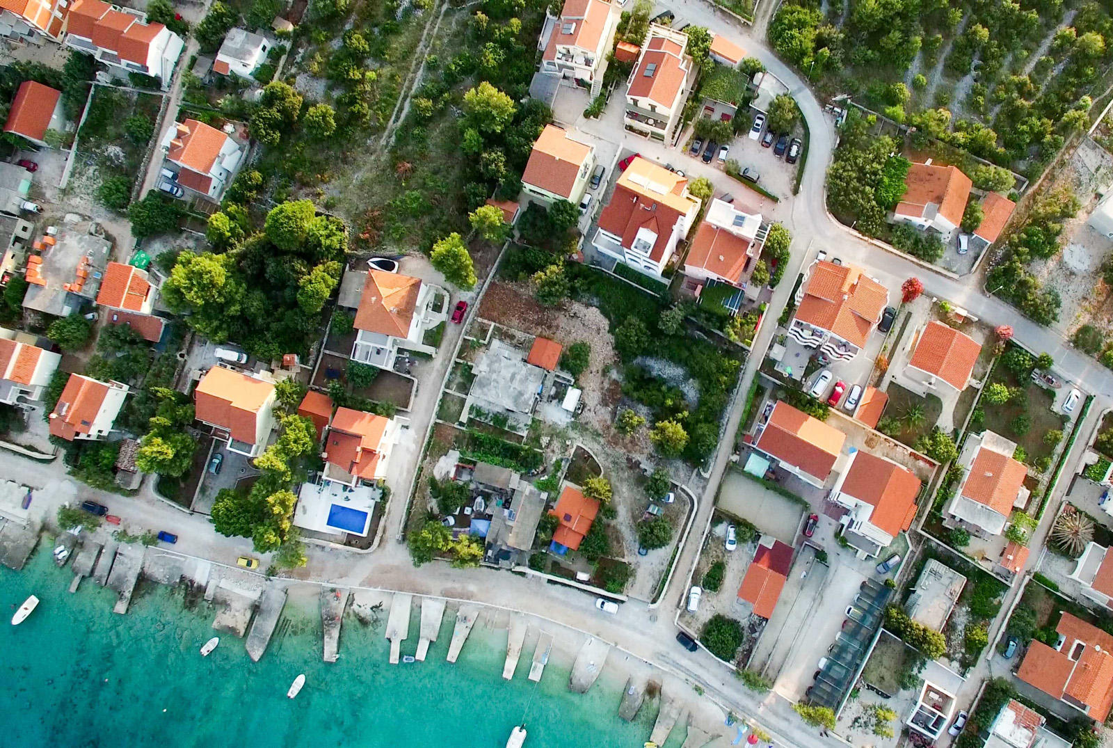 Overhead view of red roof houses near shore