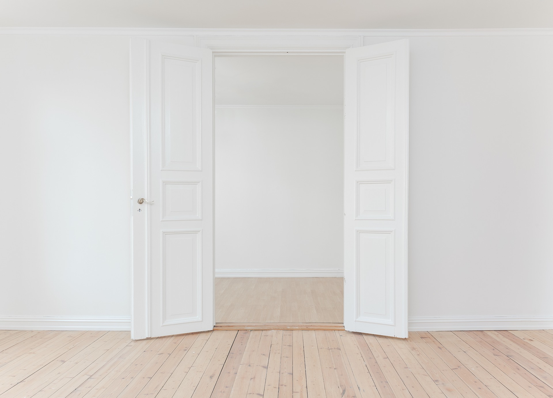 open white double door in empty house