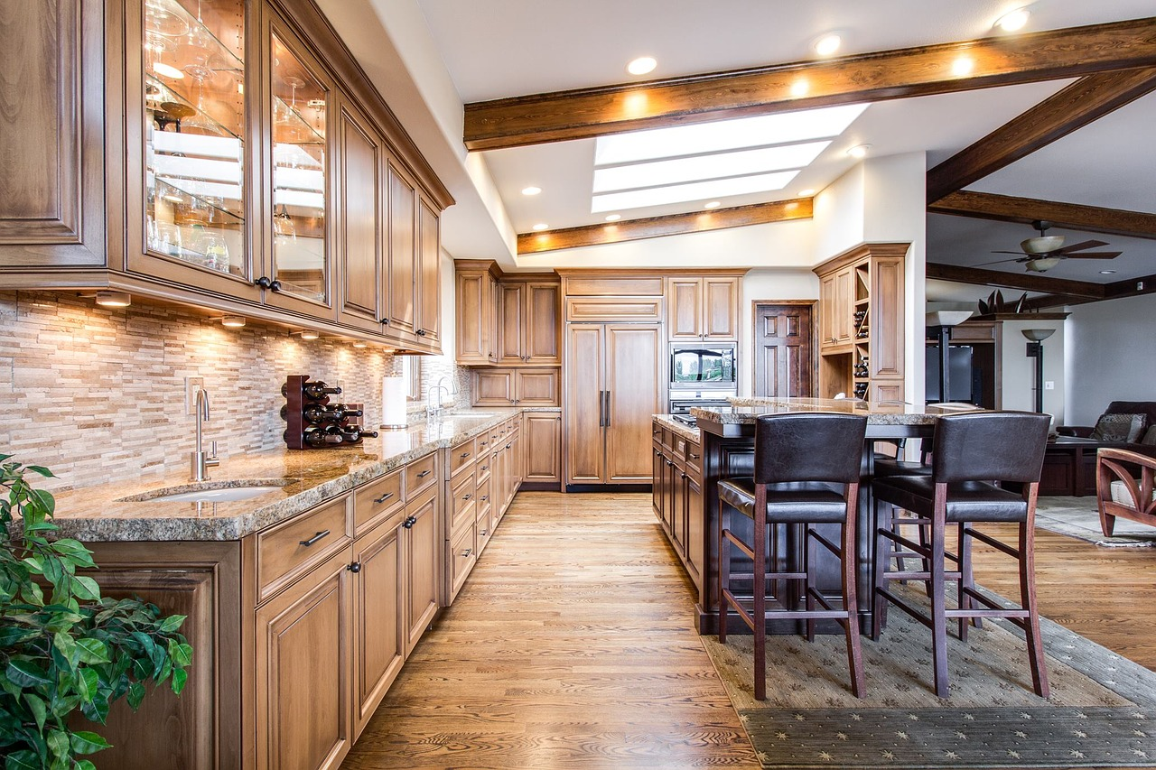 home with wood cross beams and granite counter tops