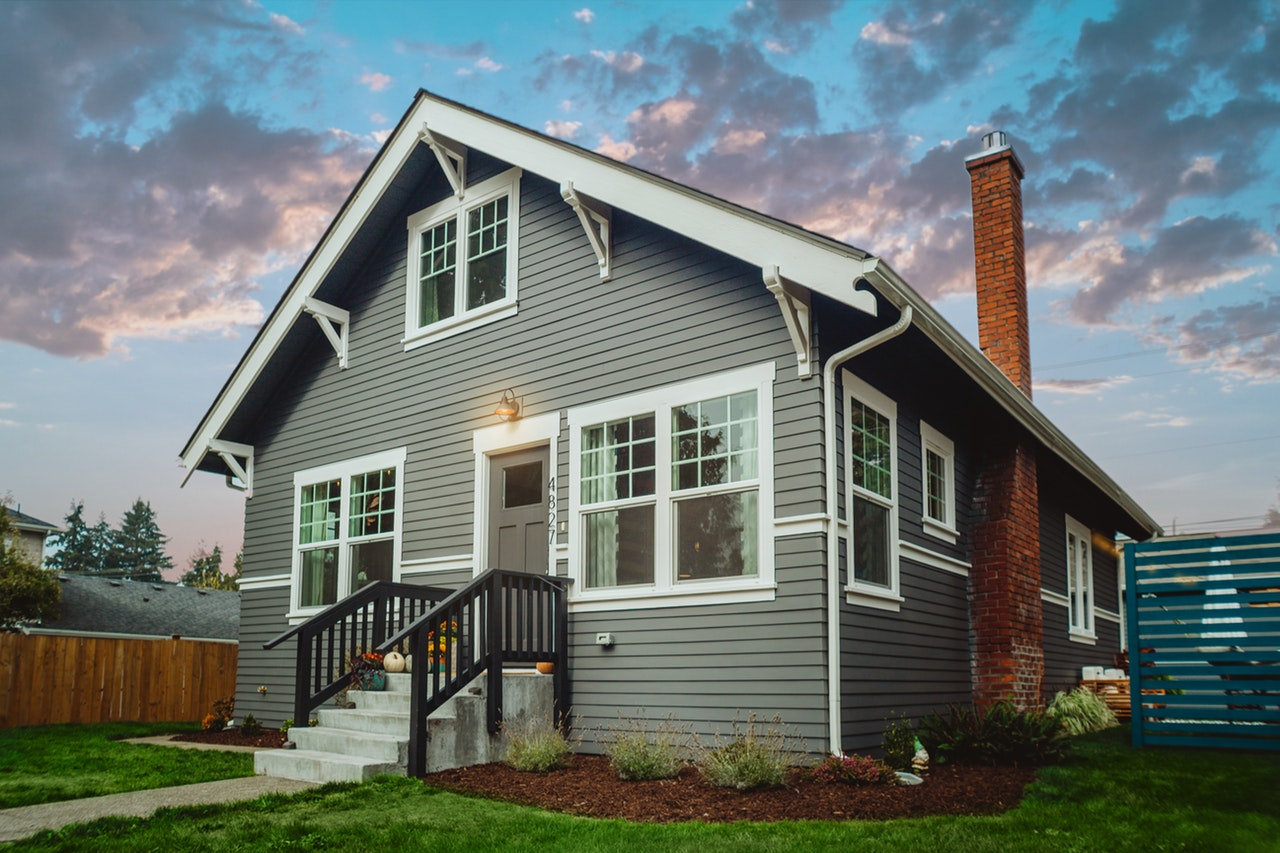 new home with vinyl siding under colorful sky