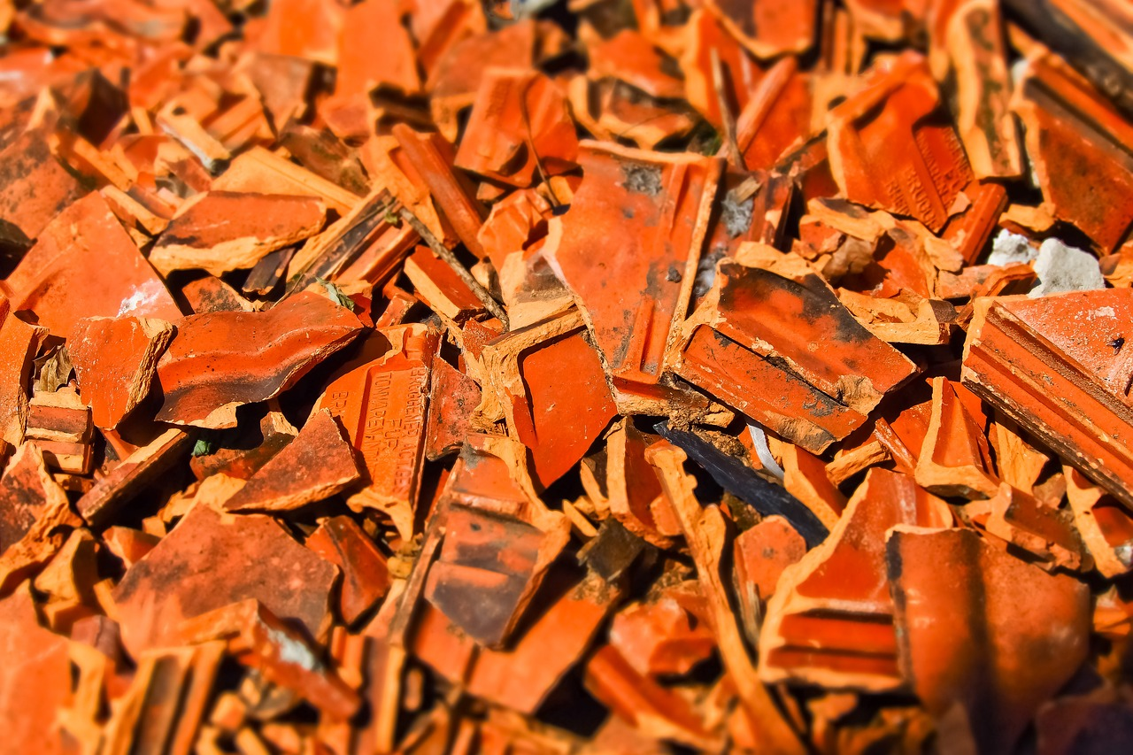 pile of broken red clay shingles