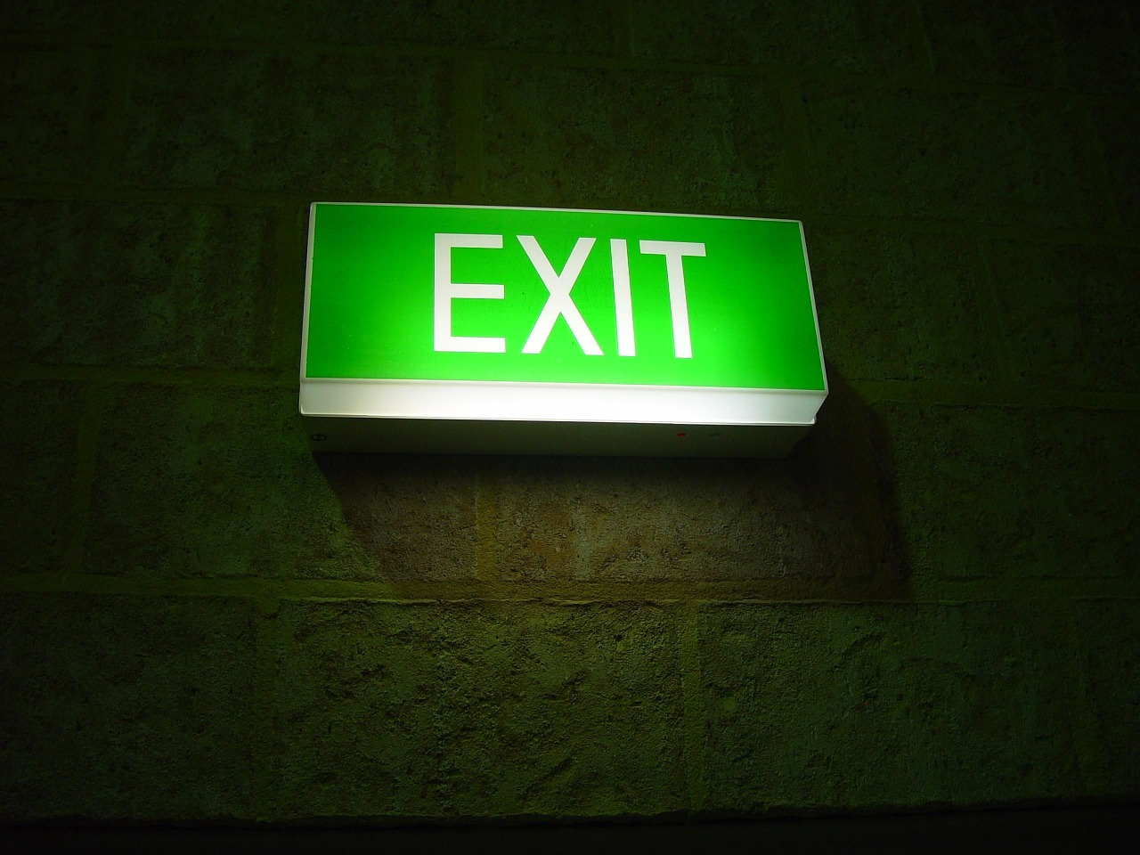 green lit exit sign