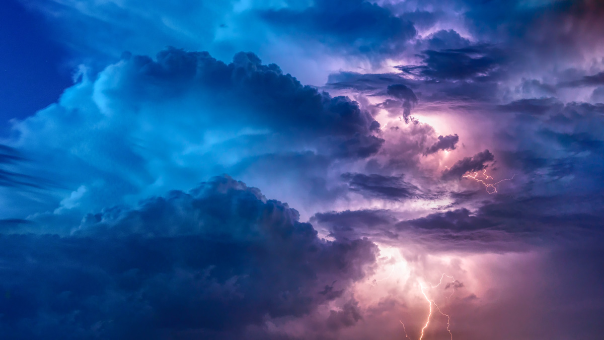 purple and blue storm clouds with lighting strike