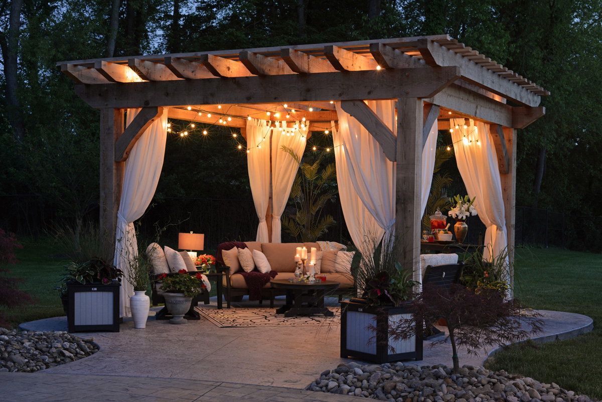 wooden gazebo with curtains and lighting