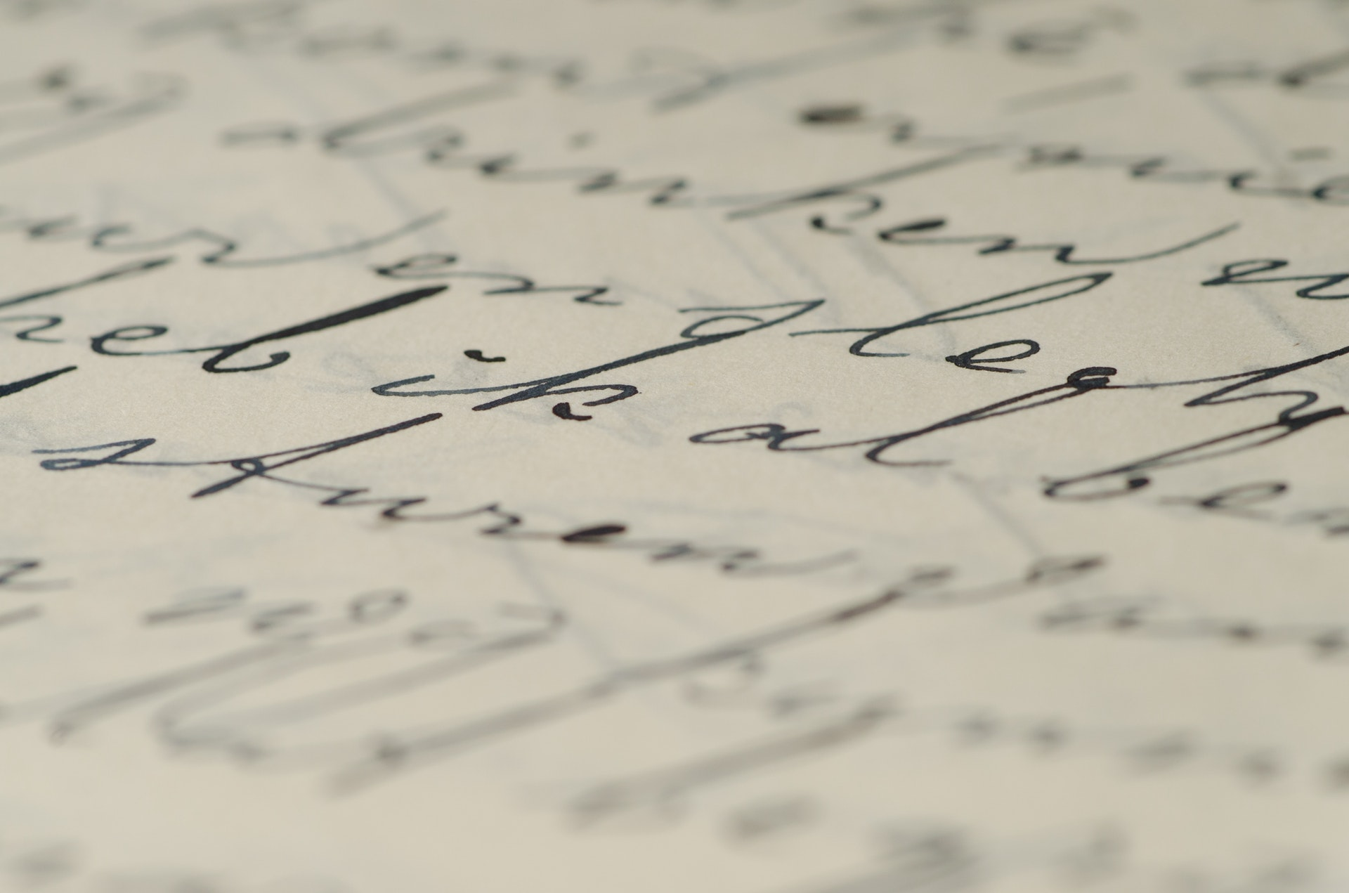 old world cursive on paper document