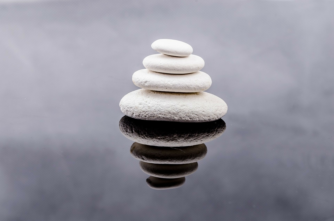 white rounded stones stacked on water