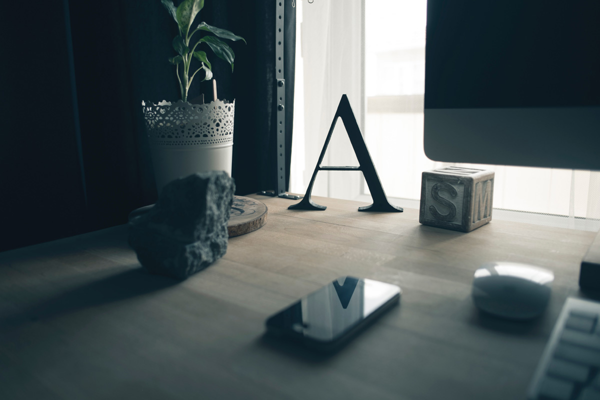 the letter A on a desk in a dark room