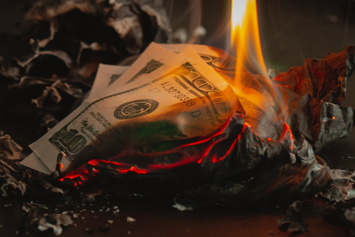 hundred dollar bills on fire