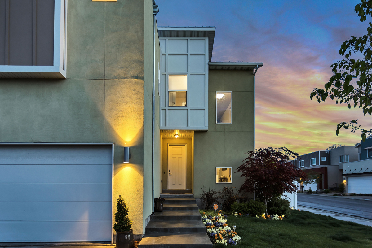 stucco home at night with golden light