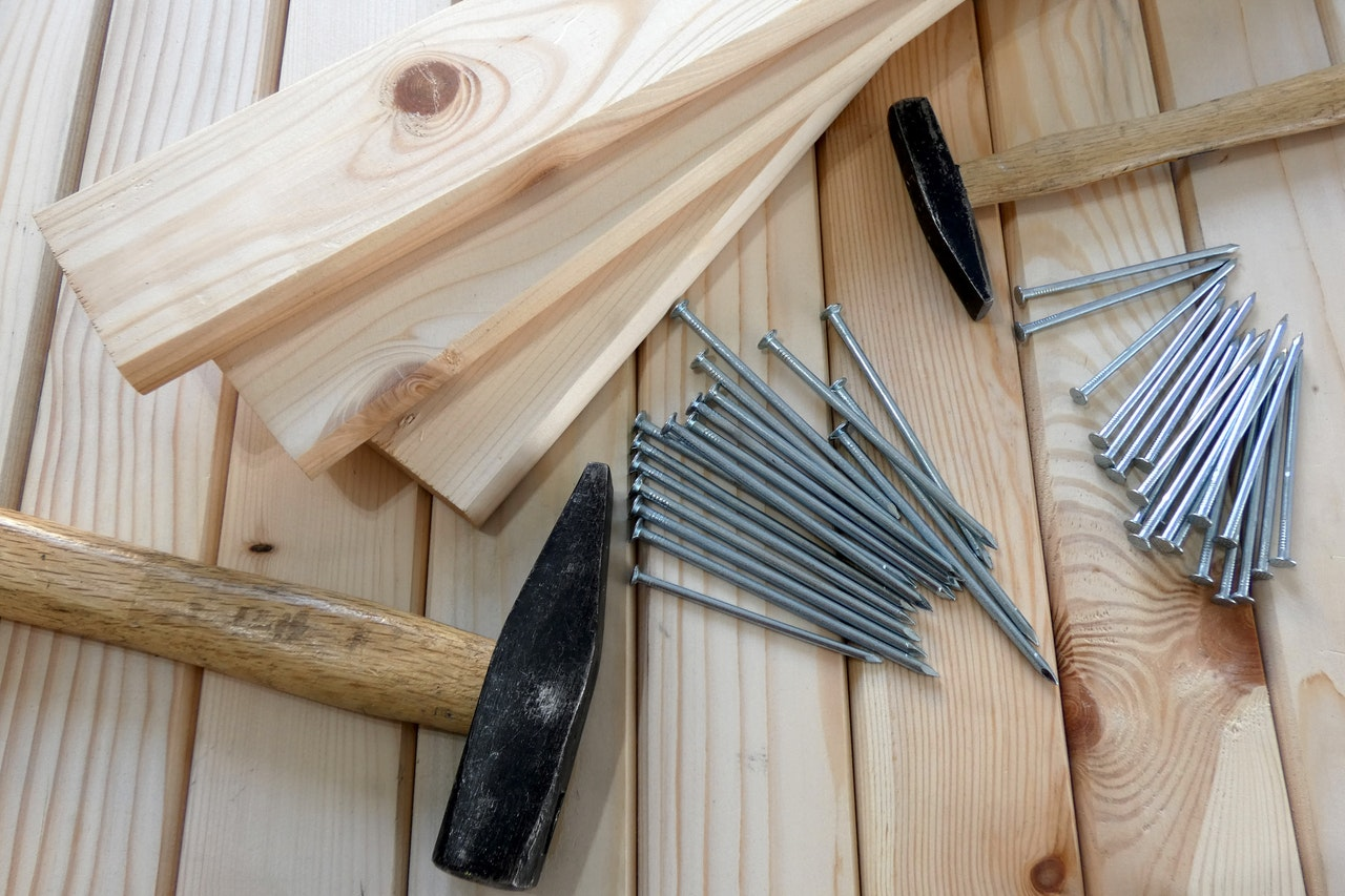 hammer, nails, and wooden boards