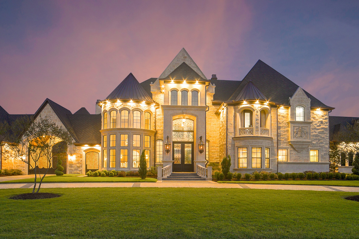 large stone manor house with nice lighting