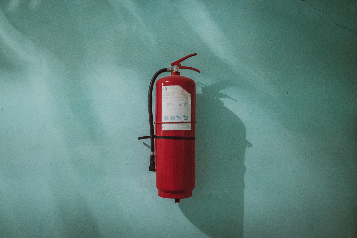 fire extinguisher on green background