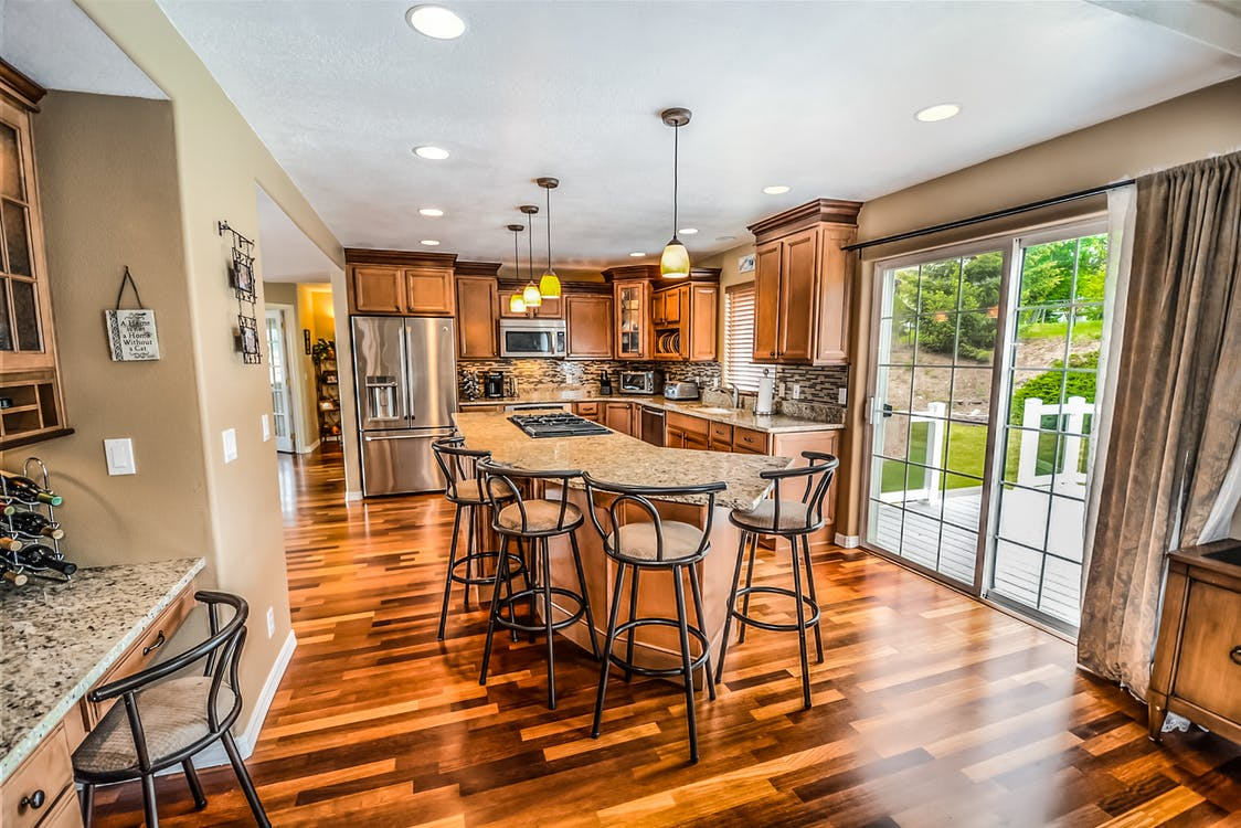 kitchen with wood floors and granite counter tops